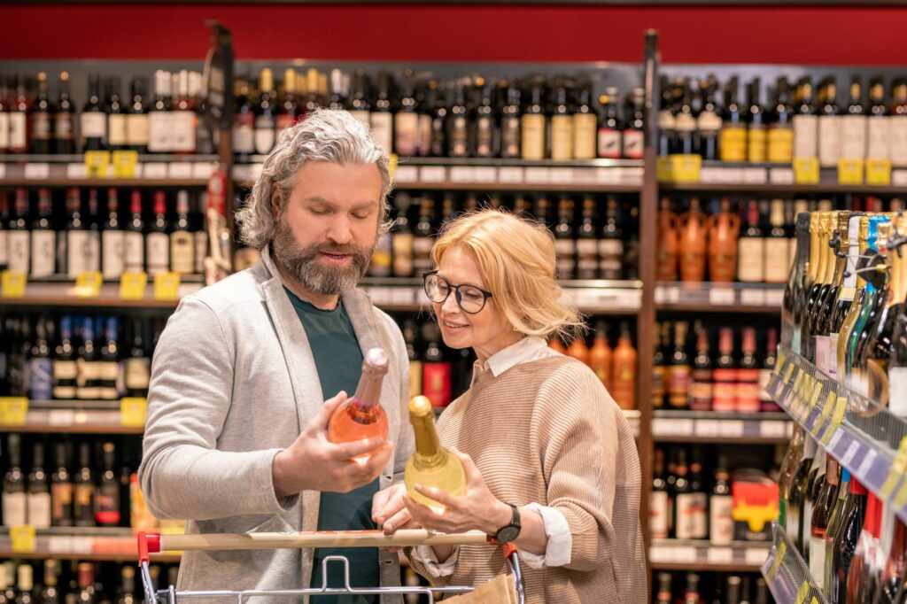 Customers reading label of wine making sure it's not counterfeit